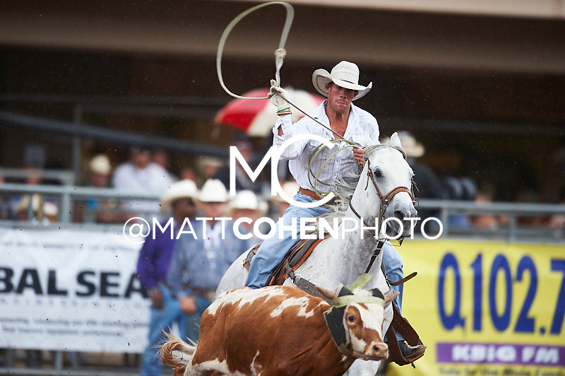 Team roper Tony Mendes of Fruita, CO competes at the Pikes Peak or Bust Rodeo in Colorado Springs, CO.<br /> <br /> <br /> UNEDITED LOW-RES PREVIEW<br /> <br /> <br /> File shown may be an unedited low resolution version used as a proof only. All prints are 100% guaranteed for quality. Sizes 8x10+ come with a version for personal social media. I am currently not selling downloads for commercial/brand use.