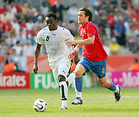Photo: Chris Ratcliffe.<br /> Czech Republic v Ghana. Group E, FIFA World Cup 2006. 17/06/2006.<br /> Michael Essien of Ghana clashes with Tomas Rosicky of the Czech Republic.