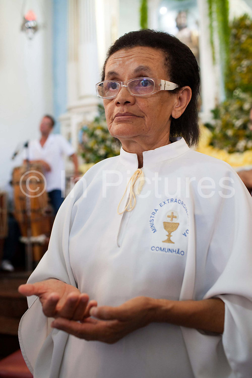 Woman dressed in white. Often the lines between Candomble and Catholicism are blurred. This is especially true with the Sao Lazaro event in late January in Salvador, Bahia, Brazil, the city which is known as the home of Candomble. Sao Lazaro represents healing and the sick.
