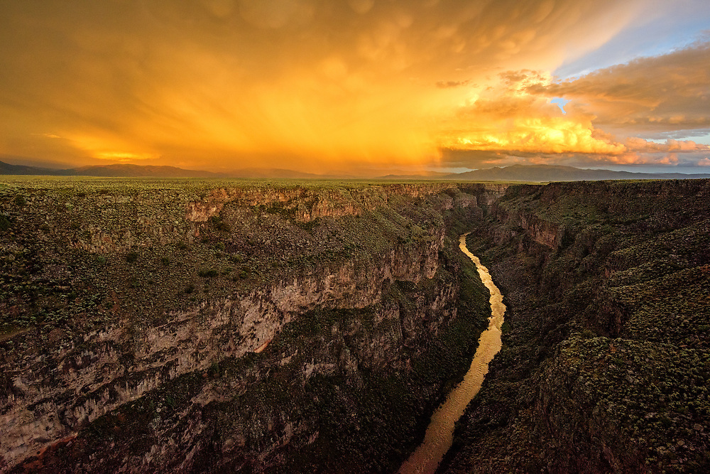I'd been photographing lightning strikes in the rain off highway 522, and as the sun dipped low, I raced to the Gorge Bridge, arriving in time to witness this sunset palette reflecting in the river below.