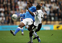 Photo: Rich Eaton.<br /> <br /> Derby County v Birmingham City. Coca Cola Championship. 21/10/2006. Cameron Jerome left of Birmingham City is stopped by Derby Captain Michael Johnson