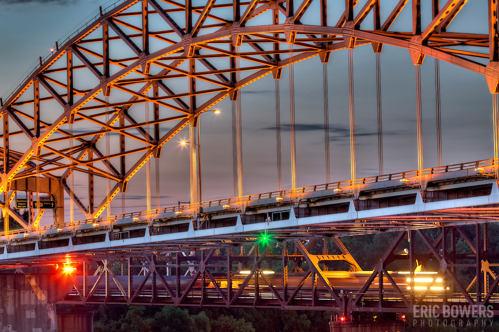 Broadway Bridge illuminated over the Missouri River at dusk in Kansas City MO.