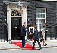 David Cameron; Samantha Cameron; Nicolas Sarkozy; Carla Bruni French President UK Visit, Downing Street, Whitehall, London, UK, 18 June 2010. For piQtured Sales contact: Ian@piqtured.com Tel: +44(0)791 626 2580 (Picture by Richard Goldschmidt/Piqtured)