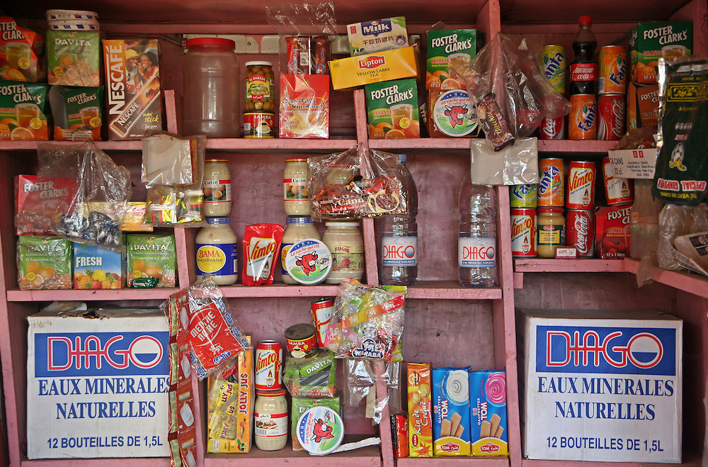 The basically stocked shelves of a roadside kiosk shop displaying all of its goods in Bamako, Mali.