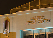 """Merrick, New York, USA. January 21, 2015. Merrick Jewish Centre, its front entrance shown here with a menorah at side, and AJC Long Island presented the event """"Terrorism in France - Where Do We Go From Here?"""" with speaker Braden-Golay, from Switzerland."""