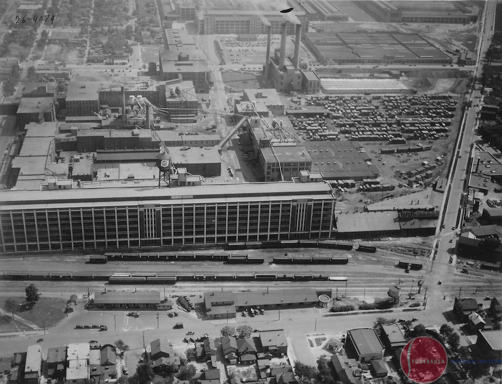 A 1926 aerial image facing south of Studebaker's South Bend plant. The Body Assembly building, #84, is shown in the foreground. South Bend's Union Station was not yet built.