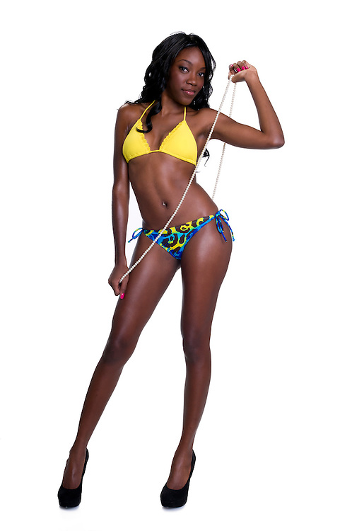 Portrait of very sensual african american in swimsuit white isolated in studio.