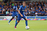 AFC Wimbledon defender Ben Purrington (3) dribbling during the EFL Sky Bet League 1 match between AFC Wimbledon and Coventry City at the Cherry Red Records Stadium, Kingston, England on 11 August 2018.