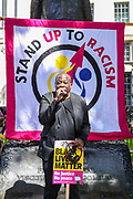 London, United Kingdom, July 17, 2021: Activist Weyman Bennett addresses protestors during Stand Up to Racism protest outside Downing Street in central London on Saturday, July 17, 2021. The protest is organised in solidarity with England players Marcus Rashford, Jadon Sancho and Bukayo Saka who were subject of racist hate crimes in Britain following the defeat of England in the Euro 2020 finals from Italy. (VX Photo/ Vudi Xhymshiti)