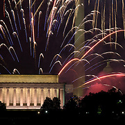 Multi-colored fireworks rain down on Washington DC monuments on July 4th