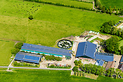Nederland, Gelderland, Gemeente Barneveld, 13-05-2019; boerenschuur (veestal) en boerderij met zonnepanelen, omgeving Barnveld.<br /> Farmer's barn (cattle stable) and farm with solar panels, Barneveld area.<br /> luchtfoto (toeslag op standard tarieven);<br /> aerial photo (additional fee required);<br /> copyright foto/photo Siebe Swart