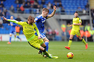 Cardiff City's Rhys Healey © is tackled  heavily by Rotherham's Joel Ekstrand. EFL Skybet championship match, Cardiff city v Rotherham Utd at the Cardiff city stadium in Cardiff, South Wales on Saturday 18th February 2017.<br /> pic by Carl Robertson, Andrew Orchard sports photography.