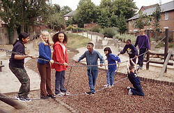 Multiracial group of teenagers in children's playground,