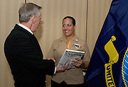 PENSACOLA, Fla. (Oct. 29, 2009) -- Retired U.S. Navy veteran Chief Petty Officer Art Giberson present the latest copy of his book 'The Crazy One's Shot Film' to Petty Officer First Class Leah Stiles on her recognition for selection to attend the next advanced military photojournalism class at Syracuse University in New York. Members of the National Association of Naval Photography (NANP) gathered for a reunion in Pensacola Beach, Florida, for a week long event of tours, meetings and awards dinner.  Photo by Johnny Bivera