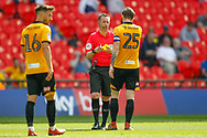 YELLOW CARD Newport County defender Mark O'Brien (25) during the EFL Sky Bet League 2 Play Off Final match between Newport County and Tranmere Rovers at Wembley Stadium, London, England on 25 May 2019.