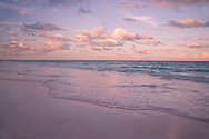 Clouds at sunset over Pink Sands Beach, Harbour Island, Eleuthera, The<br /> Bahamas