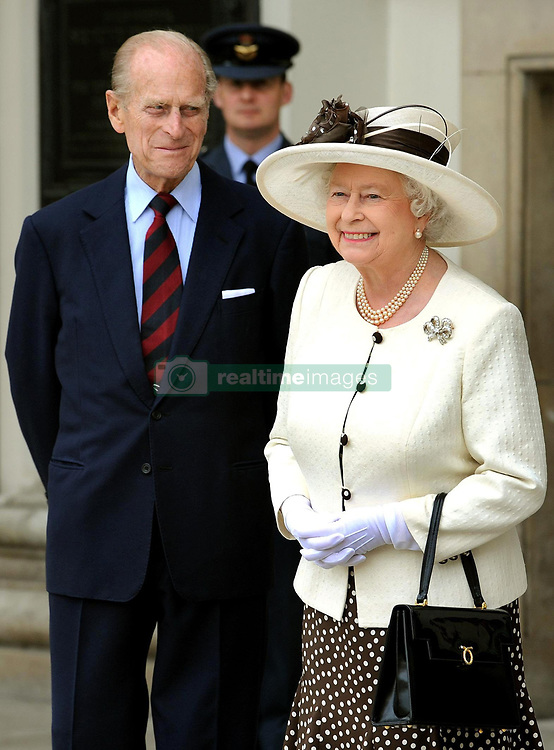 The Queen accompanied by the Duke of Edinburgh before they leave the Royal Hospital in Chelsea, west London, this afternoon.