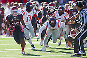 Oct 27, 2012; Little Rock, AR, USA; Arkansas Razorback running back Dennis Johnson (33) gets past Ole Miss Rebels defensive end Channing Ward (11) and other defenders during a game at War Memorial Stadium. Ole Miss defeated Arkansas 30-27. Mandatory Credit: Beth Hall-US PRESSWIRE