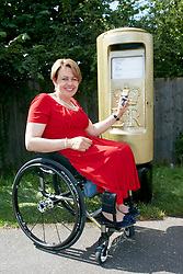 © Licensed to London News Pictures.  28/08/2012. STOKE MANDEVILLE, UK. Former Paralympic athlete Dame Tanni Grey-Thompson (pictured) helps paint a gold postbox outside Stoke Mandeville Stadium, birthplace of the Paralympic Games. The Royal Mail has promised to paint a postbox in the home town of every gold medal winner in the Paralympic Games. . Photo credit :  Cliff Hide/LNP