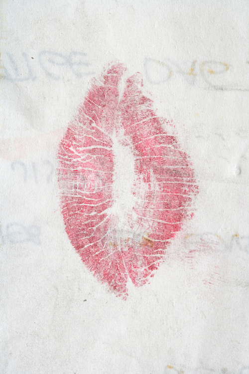 closed letter with lipstick kiss on the outside