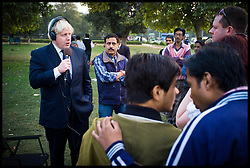 The London Mayor Boris Johnson during an radio interview at the India Gate, New Delhi, on day one of his 6 day tour of India, Sunday November 25, 2012. Photo by Andrew Parsons / i-Images