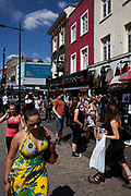 Street scene on a busy summer day at Camden Market, North London. Camden Lock is a crowded hang out for young Londoners and tourists.