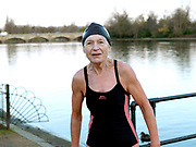 Portrait of Mary Olivari, a member of the Serpentine Swimming Club, Hyde Park, London, UK. The Serpentine Lake is situated in Hyde Park, London's largest central open space. The Serpentine Swimming Club was formed in 1864 'to promote the healthful habit of bathing in open water throughout the year'.  Its headquarters were beneath an old elm tree on the south side of the lake, a wooden bench for clothing being the only facility.  At this time London was undergoing rapid expansion and Hyde Park was now in the centre of a densely populated built up area and provided a place of relaxation to its urbanised masses. Now, the club has its own (somewhat spartan) changing facilities and members are  permitted by the Royal Parks to swim in the lake any morning before 09:30.  They race every Saturday morning throughout the year, regardless of the weather.