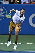 NICK KYRGIOS hits a serve at the Rock Creek Tennis Center.