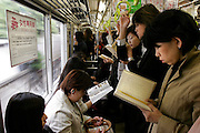 """Women only car in KEIO line during the women-only morning time. In Tokyo, Wednesday 11 May, 2005.. In an attempt to combat the growing problem of gropers assaulting women in jam-packed trains, nine private railways and subway trains operated by the Tokyo metropolitan government introduced """"women only"""" cars Monday during the morning rush hour."""