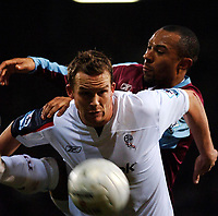 Photo: Daniel Hambury.<br />West Ham United v Bolton Wanderers. The FA Cup. 15/03/2006.<br />West Ham's Danny Gabbidon struggles to contain Bolton's Kevin Davies.