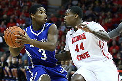 12 January 2013: Richard Carter looks to get the ball past Johnny Hill  during an NCAA Missouri Valley Conference mens basketball game Where the Bulldogs of Drake University beat the Illinois State Redbirds 82-77 in Redbird Arena, Normal IL