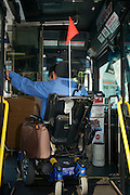 Bruce Oka boarding the 38 line bus using the wheelchair lift in San Francisco