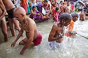 Pilgrims bathing on the Ganges river in Varanasi in India.