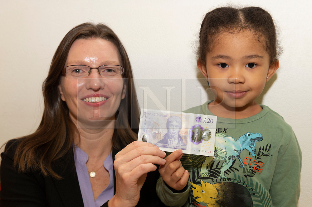 © Licensed to London News Pictures. 20/02/2020. London, UK.  Bank of England Chief Cashier and Director of Notes Sarah John (L) and 3 year old Lily Ruva Tang (R) pose with the new £20 banknote. Sarah John's signature is featured on the new banknote. Photo credit: Ray Tang/LNP