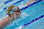 Senior Sadie Allen swims butterfly in Centre's only December meet. Held outdoors at a local pool, Centre is required by NCAA rules to compete. St. Rose and Washington and Jefferson also train in the area and were more then happy to compete. Centre's women beat both teams while Centre's men came home with one win and one loss from the meet.