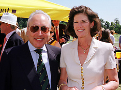 MR & MRS URS SCHWARZENBACH he is the multi millionaire polo patron, at a polo match in West Sussex on 18th July 1999.MUH 55