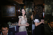 Dita von Teese. charles Finch and Chanel 6th Anniversary Pre-Bafta party to celebratew A Great Year of Film and Fashion Beyond the Red Carpet at Annabel's. Berkeley Sq. London W1. 18 February 2006. ONE TIME USE ONLY - DO NOT ARCHIVE  © Copyright Photograph by Dafydd Jones 66 Stockwell Park Rd. London SW9 0DA Tel 020 7733 0108 www.dafjones.com