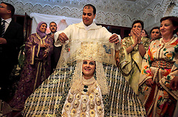 Meryem Benanine, 32, and Nabil Abou et Ainine, 33, are married in a traditional ceremony arranged by their families in Casablanca, Morocco on May 10, 2009.