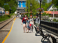 Liberty Ahern, Alex Bradstreet, Victoria Bradstreet and Hunter Brady walk down the boardwalk towards Weirs Beach on Wednesday afternoon.   (Karen Bobotas/for the Laconia Daily Sun)