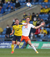 Blackpool's Jerry Yates and Oxford United's Cameron Brannagan<br /> <br /> Photographer Rob Newell/CameraSport<br /> <br /> Sky Bet League One Play-Off Semi-Final 1st Leg - Oxford United v Blackpool - Tuesday 18th May 2021 - Kassam Stadium - Oxford<br /> <br /> World Copyright © 2021 CameraSport. All rights reserved. 43 Linden Ave. Countesthorpe. Leicester. England. LE8 5PG - Tel: +44 (0) 116 277 4147 - admin@camerasport.com - www.camerasport.com