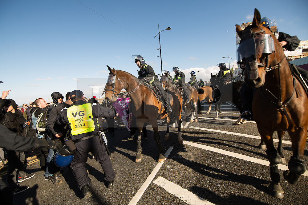 © Licensed to London News Pictures . 22/10/2016 . Margate , UK . Mounted police attempt to separate anti fascists and White Lives Matter marchers . A White Lives Matter protest and march , opposed by antifascists , is held in Margate , Kent . Photo credit : Joel Goodman/LNP