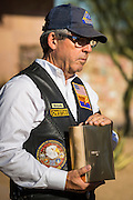 08 OCTOBER 2013 - PHOENIX, AZ:  A member of the Patriot Guard Riders honor guard unit holds an urn containing the cremated remains of a US military veteran. The cremated remains of 36 unclaimed US military veterans were interred at the National Memorial Cemetery in Phoenix. Members of the US military and several hundred veterans of the US military attended the service, which was a part of the Missing In America Project (MIAP).   PHOTO BY JACK KURTZ