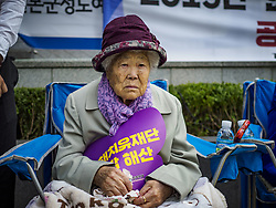 October 10, 2018 - Seoul, Gyeonggi, South Korea - GIL WON-OK, one of the few surviving ''comfort women'' at the Wednesday Demonstration to protest Japan's sexual enslavement of Korean women during World War II. She said she was forced into sexual slavery when she was 13 years old and she was forced to service up to 20 Japanese soldiers per day, every day. The Wednesday protests have been taking place since January 1992.. (Credit Image: © Jack Kurtz/ZUMA Wire)