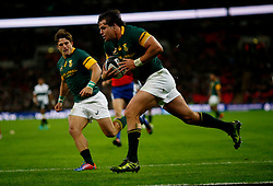 South Africa's Francois Venter scores their fourth try during the Killik Cup match at Wembley Stadium, London.