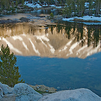 Mountains and Whitebark Pines reflect in Marsh Lake, in Little Lakes Valley at the head of Rock Creek Canyon in California's eastern Sierra Nevada.