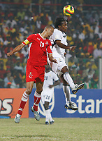 Photo: Steve Bond/Richard Lane Photography.<br />Ghana v Namibia. Africa Cup of Nations. 24/01/2008. Baffour Gyan (R) and Michael Pienaar (L) challange in the air