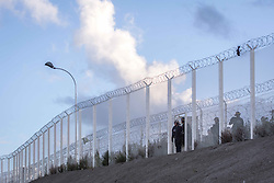 October 1, 2016 - Calais, France - French police patrol the borders of the port of Calais in Setques, France on October 1, 2016. Between 7,000 and 10,000 migrants are currently living in the ''Jungle'', the launchpad for their attempts to stow away on lorries heading across the Channel to England. Rights groups have criticised the hardship and dangers facing the migrants living in the camp, particularly the hundreds of unaccompanied minors. (Credit Image: © Julien Mattia/NurPhoto via ZUMA Press)