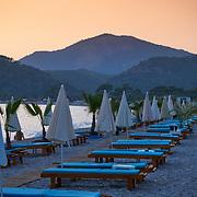 Beach beds in Oludeniz beach on sunset, Turkey