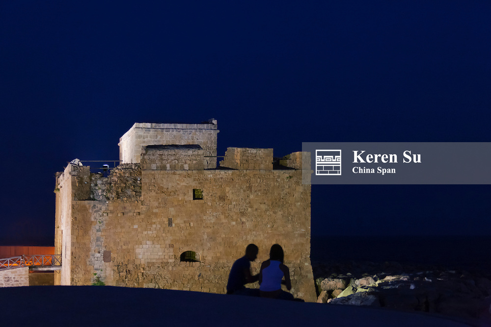 Tourists watching the Medieval Castle of Paphos (Pafos) at night, Republic of Cyprus
