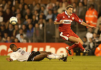 Picture: Henry Browne.<br />Date: 25/08/2004.<br />Fulham v Middlesborough FA Barclays Premiership.<br /><br />Franck Queudrue of Borough gets brought down by Fulham's Collins John